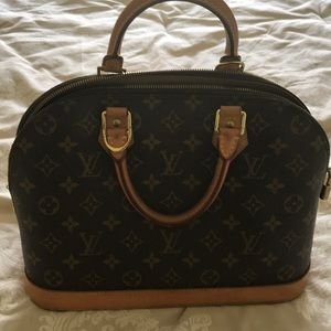 Louis Vuitton bag 2 years old
